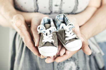 Fertility Counseling & Support, couple holding baby shoes