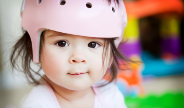 a kid with a pink helmet